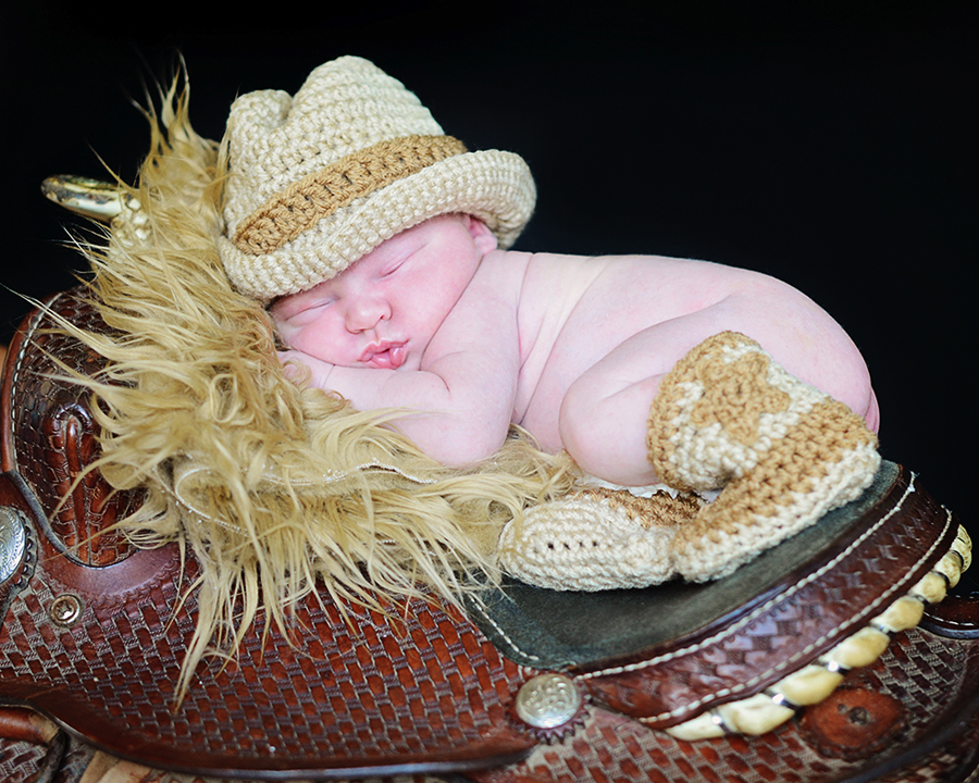 Newborn on saddle